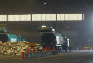 Trash delivered to the tipping floor in Transfer Station Image