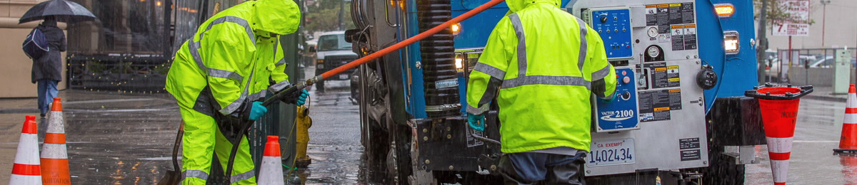 Clearing stormdrains in the rain - hero for homepage
