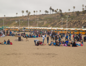 School buses brought nearly 4,500 students from across Los Angeles to participate in the 25th Annual Kids Ocean Day cleanup activities at Dockweiler State Beach in Playa del Rey.