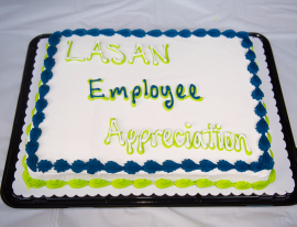 A cake was presented honoring the recipients.