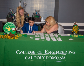 Check-in table staffed by current Cal Poly engineering students.